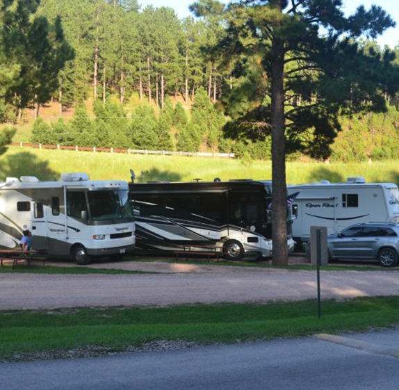 RVs parked at Holy Smoke Resort in the Black Hills of South Dakota with full hook ups